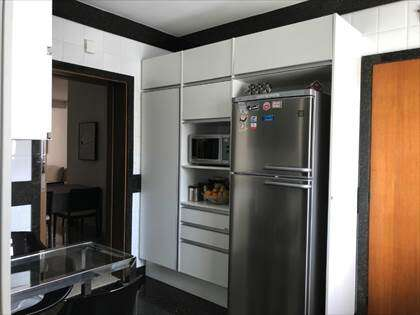cozinha com armários linha d`oro