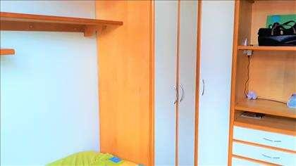 Detalhes dos armários do quarto de casal.